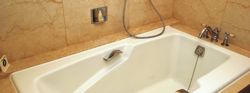 Bathtub in a luxurious hotel room. Suitable for concepts such as business and executive travel, tourism, vacation and holiday, spa, wellness and relaxation.
